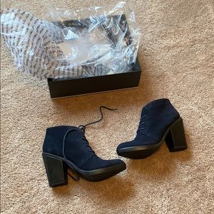Brand new in box booties navy.